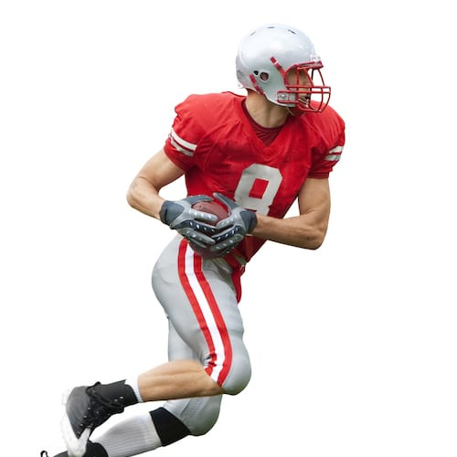 Football player with athletic mouthguard