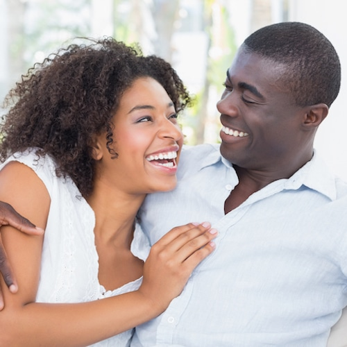 African American Couple Smiling at each other