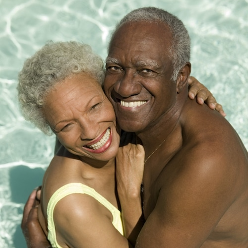 African American Couple Smiling in a Pool
