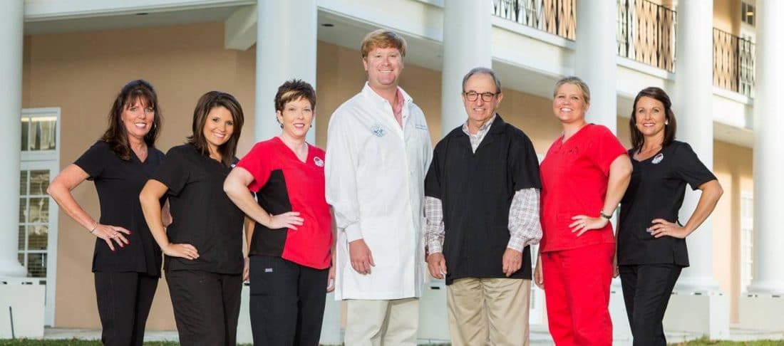 Group picture of the dental team at Plantation Dental Associates